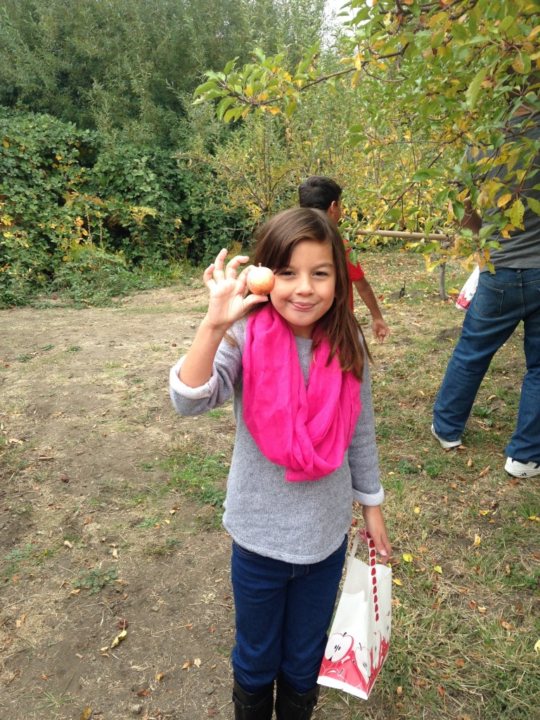 My daughter with one of the apples she picked.